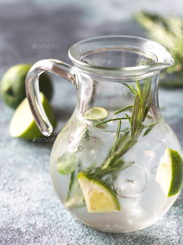 Glass jar of water with herbs - Stock Photo - Images