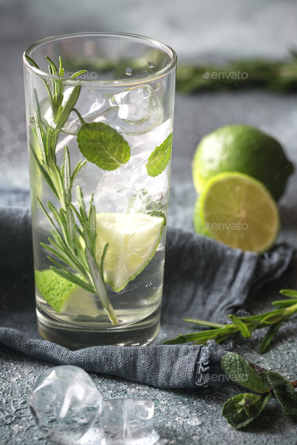 Glass of lime water with herbs - Stock Photo - Images