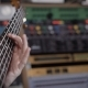 Shot of Ambitious Musician Holding a Bass Guitar in His Hands - VideoHive Item for Sale