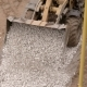 a Close Shot on a Metal Ladle, Heavy Machinery Unloads Small Stones, Pebbles on the Road, in Order - VideoHive Item for Sale