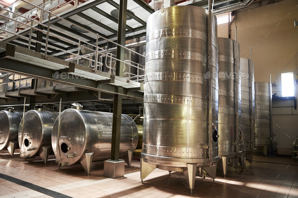Metal winemaking equipment in a modern winemaking facility - Stock Photo - Images