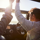 Young couple driving with sunroof open and hands in the air - PhotoDune Item for Sale