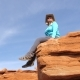 Caucasian Woman Tourist Sitting On A Stone Rock In Grand Canyon - VideoHive Item for Sale