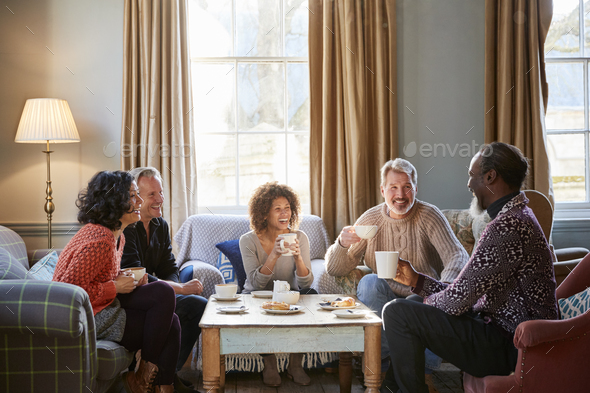 Group Of Middle Aged Friends Meeting Around Table In Coffee Shop - Stock Photo - Images