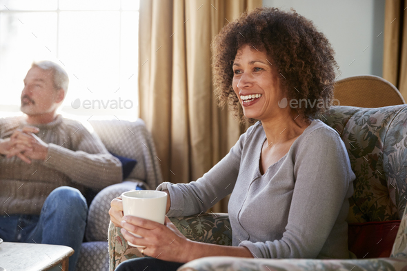 Middle Aged Couple Meeting Friends Around Table In Coffee Shop - Stock Photo - Images