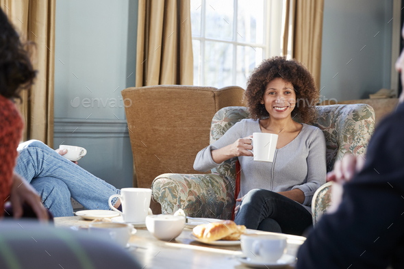 Middle Aged Woman Meeting Friends Around Table In Coffee Shop - Stock Photo - Images