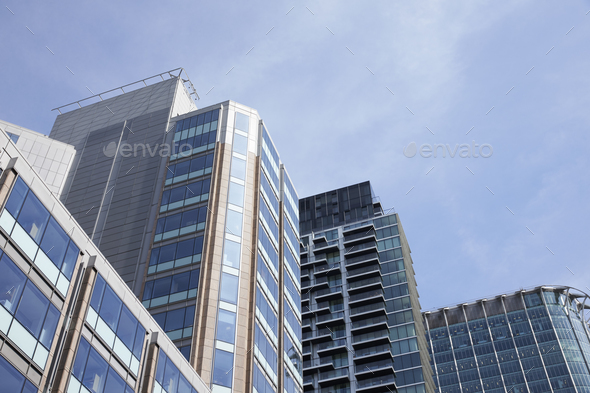 LONDON - MAY, 2017: Low angle view of modern glass fronted buildings  - Stock Photo - Images