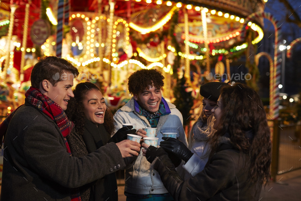 Group Of Friends Drinking Mulled Wine At Christmas Market - Stock Photo - Images