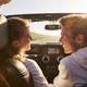 Young adult couple driving looking at each other - PhotoDune Item for Sale