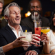 Group Of Middle Aged Friends Celebrating In Bar Together - PhotoDune Item for Sale