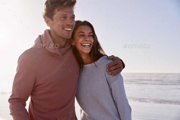 Romantic Couple On Walking Along Winter Beach Together - Stock Photo - Images
