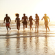 Group Of Friends Run Through Waves Together On Beach Vacation - PhotoDune Item for Sale