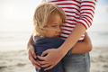 Close Up Of Mother Hugging Son On Summer Beach Vacation - PhotoDune Item for Sale