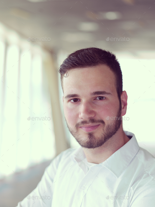 portrait of young  business man with beard at modern office - Stock Photo - Images