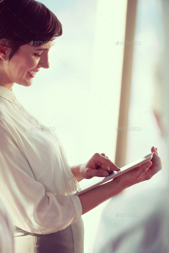 business woman working on tablet computer - Stock Photo - Images