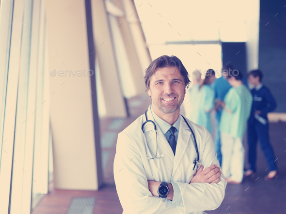 group of medical staff at hospital, doctor in front of team - Stock Photo - Images