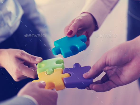 business people group assembling jigsaw puzzle - Stock Photo - Images