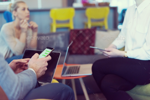 Young casual businessman using smartphone - Stock Photo - Images