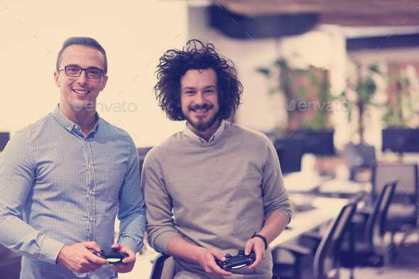 startup Office Workers Playing computer games - Stock Photo - Images