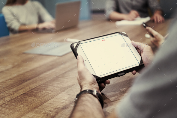 close up of businessman on meeting using tablet - Stock Photo - Images