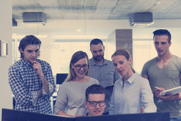 group of young startup business people standing as team - Stock Photo - Images