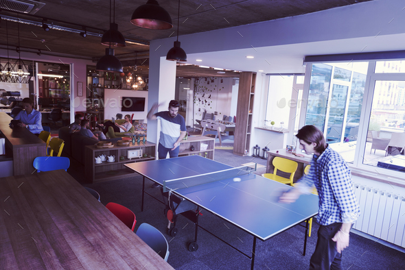 playing ping pong tennis at creative office space - Stock Photo - Images