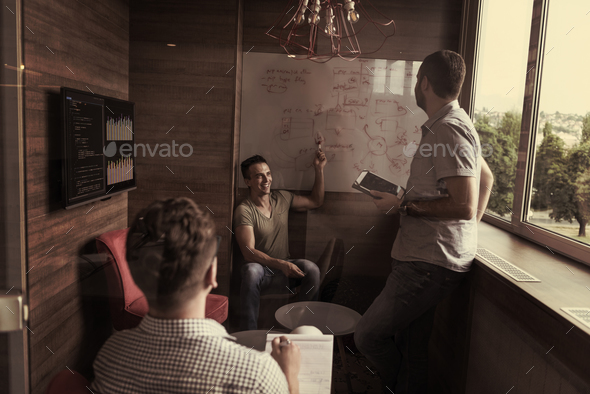 team meeting and brainstorming in small private office - Stock Photo - Images