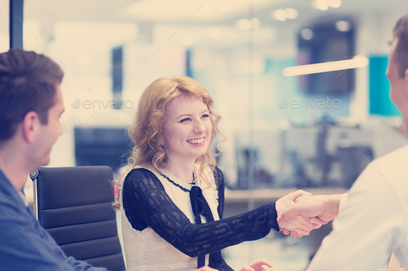 cloasing the deal in modern office interior - Stock Photo - Images
