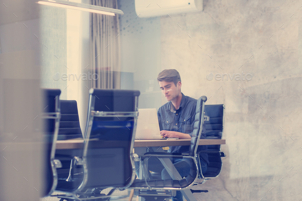 businessman working using a laptop in startup office - Stock Photo - Images