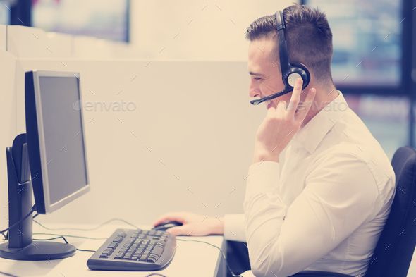 male call centre operator doing his job - Stock Photo - Images
