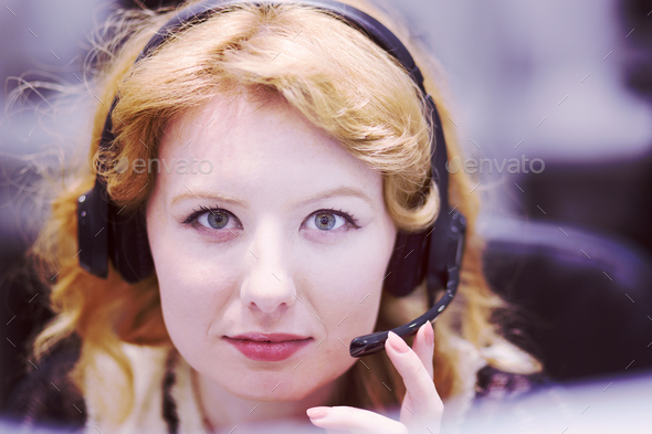 female call centre operator doing her job - Stock Photo - Images