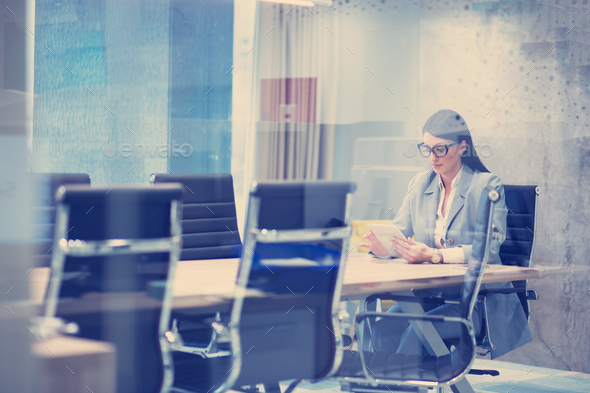 Businesswoman using tablet - Stock Photo - Images