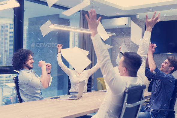 startup Group of young business people throwing documents - Stock Photo - Images
