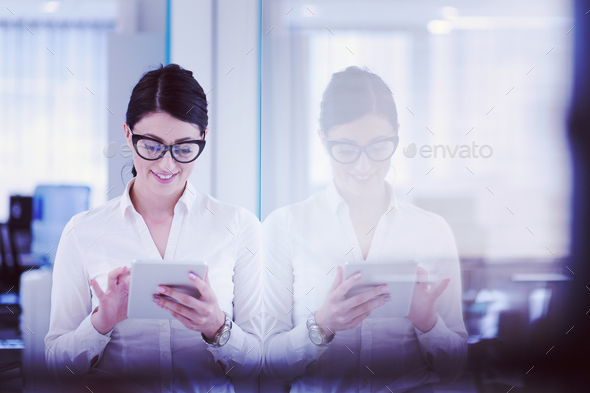 Business Woman Using Digital Tablet in front of startup Office - Stock Photo - Images