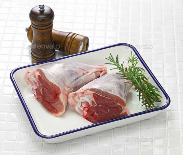 raw lamb shank isolated on white butcher tray - Stock Photo - Images