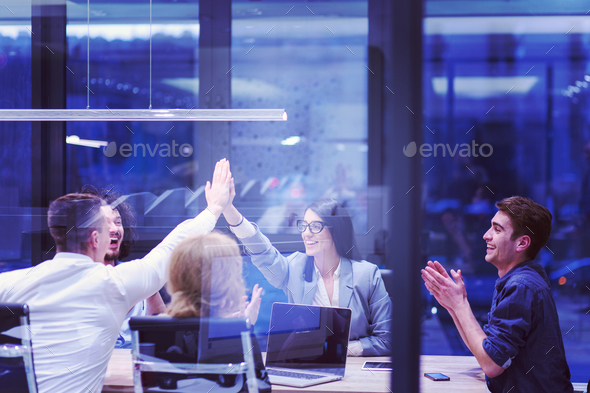 startup Group of young business people celebrating success - Stock Photo - Images
