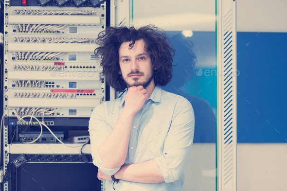 business man engeneer in datacenter server room - Stock Photo - Images