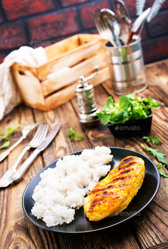 boiled rice with fried chicken breast - Stock Photo - Images