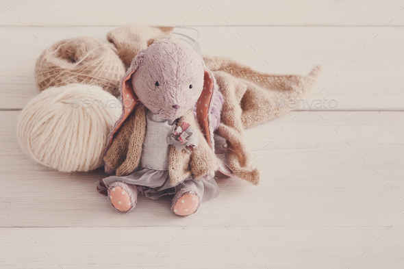 Cute handmade rabbit with wool close up - Stock Photo - Images