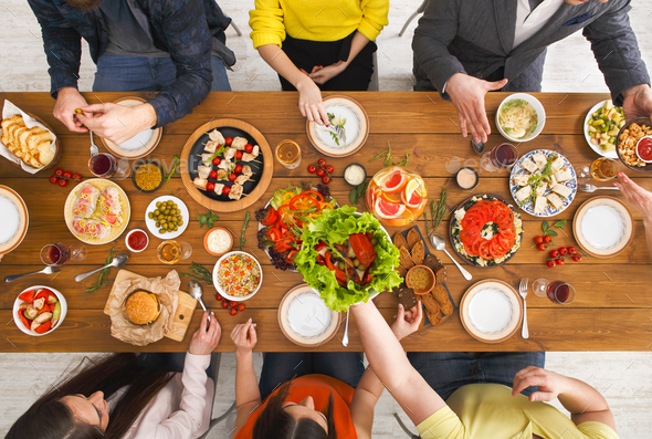 People eat healthy meals at served table dinner party - Stock Photo - Images