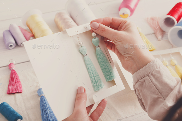 Handmade earrings packing, home workshop - Stock Photo - Images