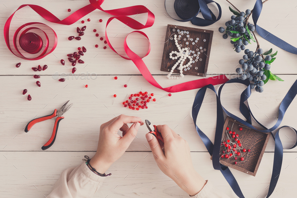 Woman making jewelry, home workshop, hobby - Stock Photo - Images