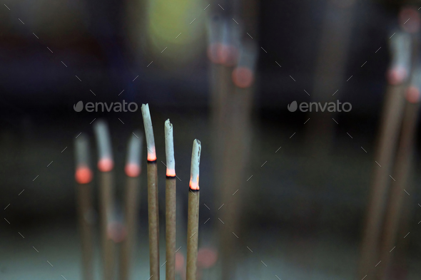 Incense sticks burn - Stock Photo - Images