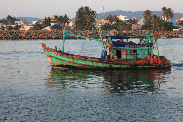 fisherman's boat goes to sea - Stock Photo - Images