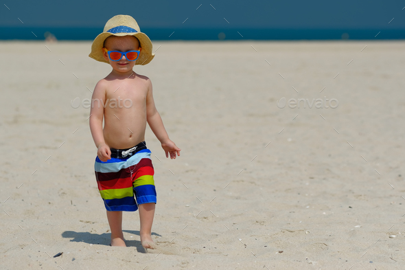 Two year old toddler boy running on beach - Stock Photo - Images