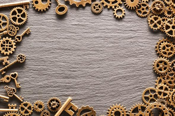 Various metal cogwheels, gear wheels and keys - Stock Photo - Images