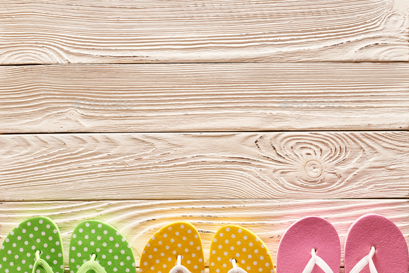 Flip-flops over wooden background - Stock Photo - Images