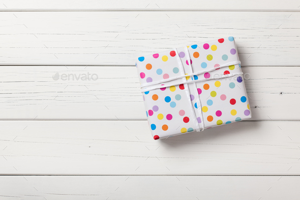 Gift box on white wooden background - Stock Photo - Images