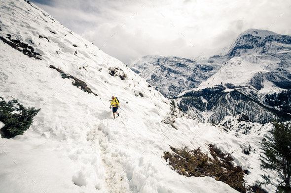 Woman hiker walking in Himalaya Mountains, Nepal - Stock Photo - Images