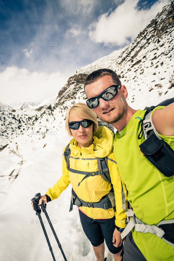 Couple hikers, partnership and teamwork in winter mountains - Stock Photo - Images